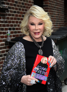 Joan Rivers With Her Book