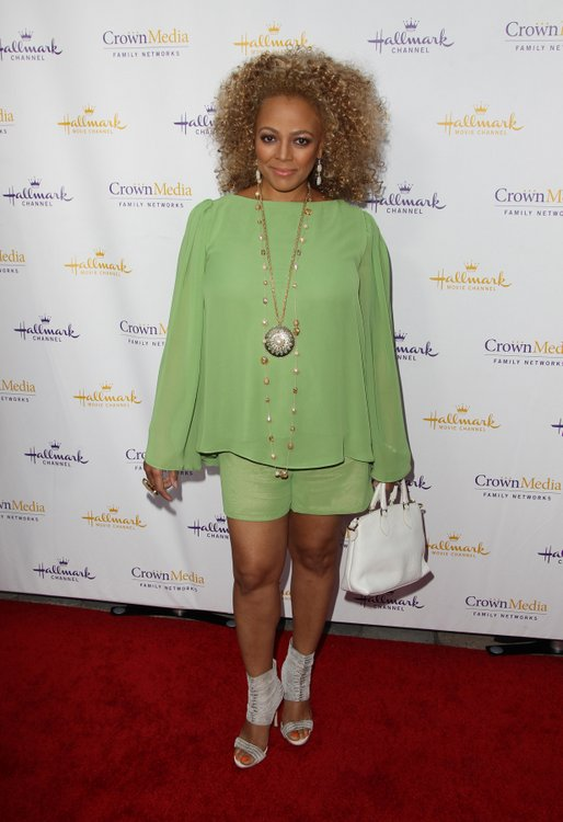 Kim Fields in green