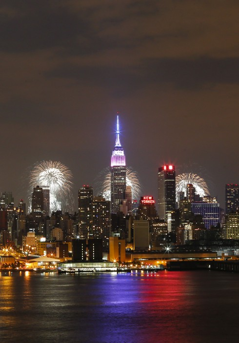 Fireworks light up the New York City skyline during 39th annual Macy's 4th of July fireworks for Independence day as seen from Weehawken, New Jersey on July 4, 2015 . PHOTO/ KENA BETANCUR (Photo credit should read KENA BETANCUR/AFP/Getty Images)