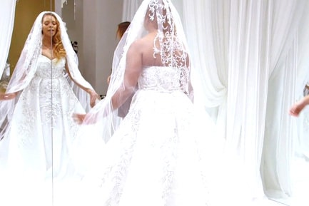 Eva Marcille tries on wedding gowns
