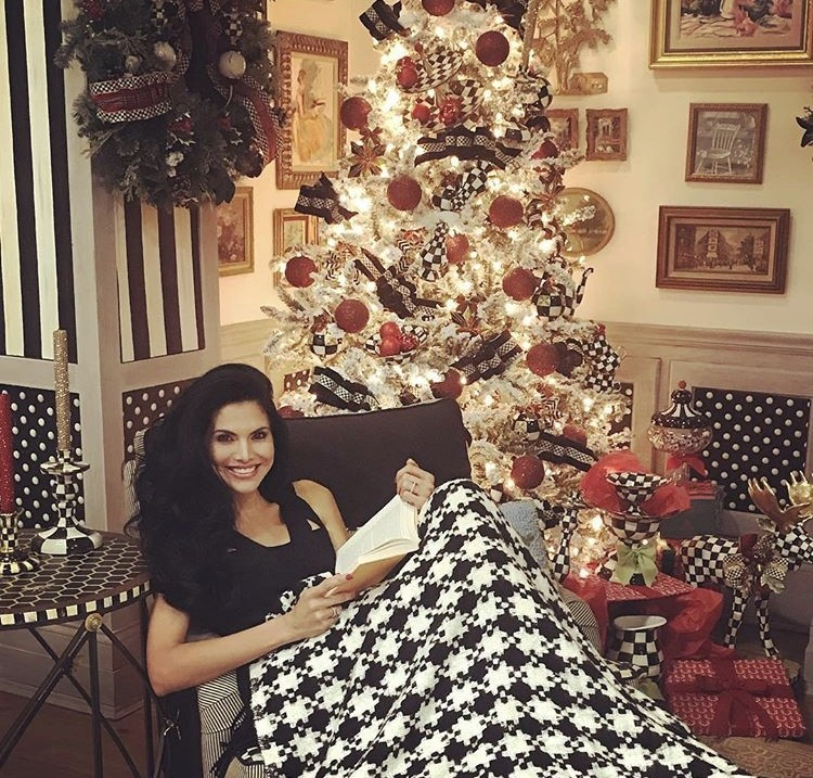 Joyce Giraud Hanging In Front Of The Tree
